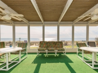 The screened front porch facing the beach and ocean